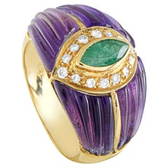 18 Karat Yellow Gold Diamonds, Emerald, and Amethyst Band Ring