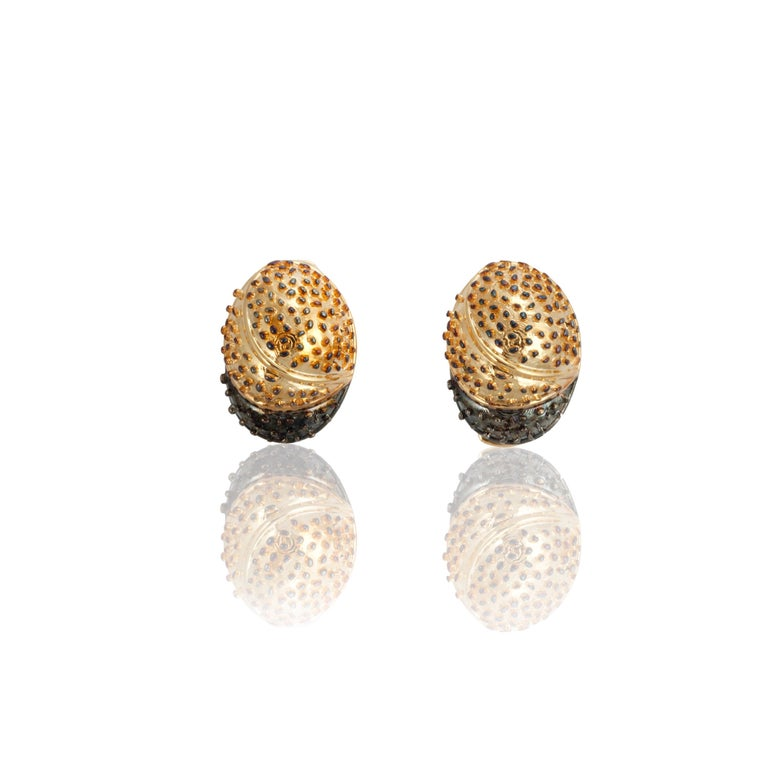 The claws of the Yellow Scorpion recreated as a pair of cufflinks with its dotted & shaded texture in 18K yellow gold.   Material: 18K gold Fancy Round Diamonds: 2 pieces, 0.01 carats (total) Dimensions: 2.5 cm (width), 2 cm (length)  Each D'Joya