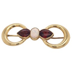 18 Karat Yellow Gold Double Ring Brooch with Opal and Garnet Stones