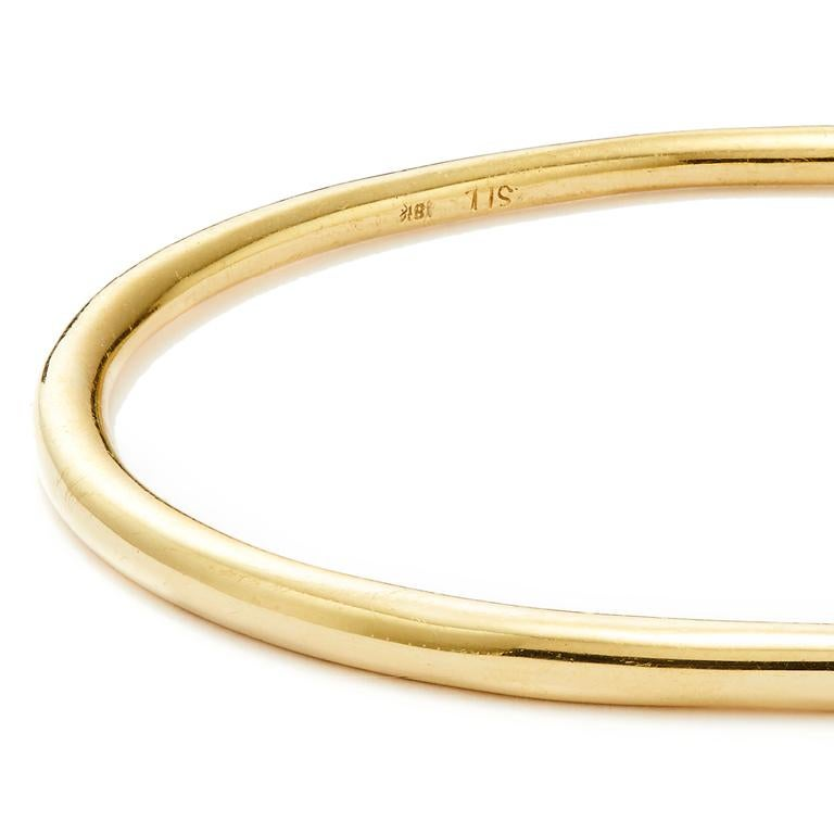 The epitome of sleek and versatile design, Susan Lister Locke's Elliptical Bangles—in 18 Karat Yellow Gold, 14 Karat Rose Gold or Sterling Silver—are designed to easily glide on the wrist and be worn with any outfit. Try layering these bangles