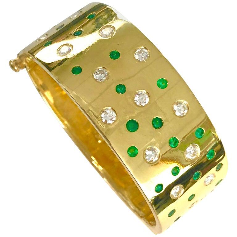 18 Karat Yellow Gold Emerald and Diamond Bangle Bracelet For Sale