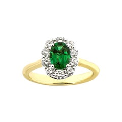 18 Karat Yellow Gold Emerald and Diamond Halo Engagement Ring