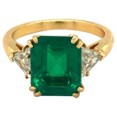 18 Karat Yellow Gold Emerald Diamond Three Stone Ring by Boucheron