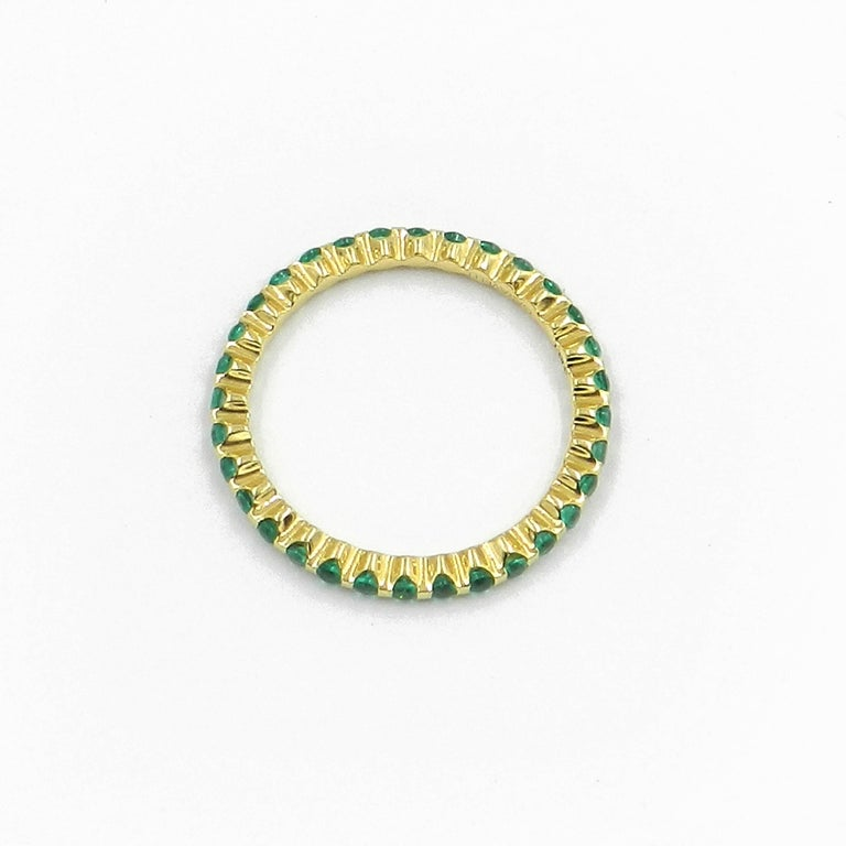 18KT Yellow Gold Emerald Garavelli  Band RING GOLD gr : 1,70 Emeralds set all around total ct : 0,43 Size: european 51 american 5.5 Any different size available as an order with delivery 4 weeks. Also available in yellow or pink sapphires, rubies,