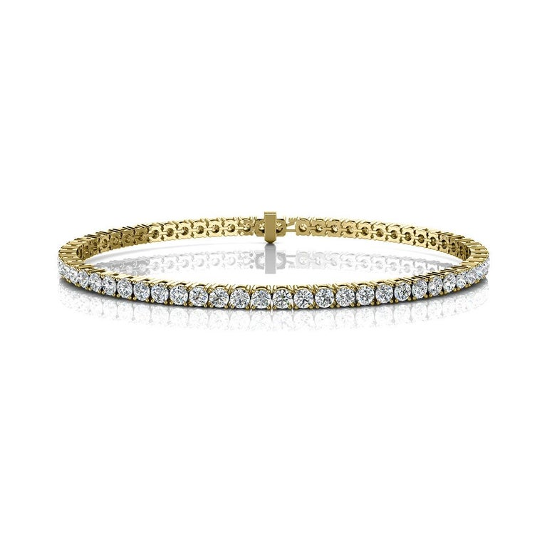A timeless four prongs diamonds tennis bracelet. Experience the Difference!  Product details:   Center Gemstone Type: NATURAL DIAMOND Center Gemstone Color: WHITE Center Gemstone Shape: ROUND Center Diamond Carat Weight: 4 Metal: 18K Yellow