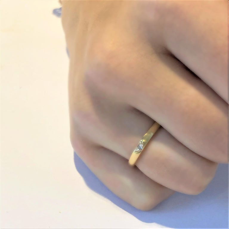 Eighteen karat yellow gold ring Half Moon Shape diamond weighing 0.17 carat    Bandwidth 2.5 millimeter     Semi matt finish                                                                Ring size 6 In Stock Ring can be resized New Ring Handmade in