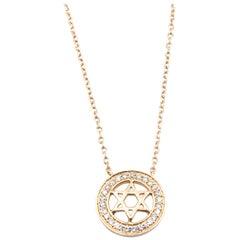 18 Karat Yellow Gold Halo Star Necklace