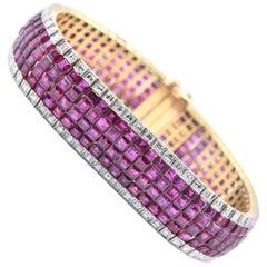 18 Karat Yellow Gold Invisible Set Diamond and Ruby Bracelet