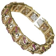 18 Karat Yellow Gold Ladies 1.80 Total Carat Weight Round Cut Ruby Bracelet
