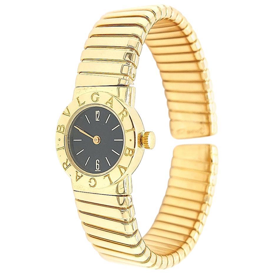 18 Karat Yellow Gold Ladies Bvlgari Tubogas Wristwatch with Black Dial