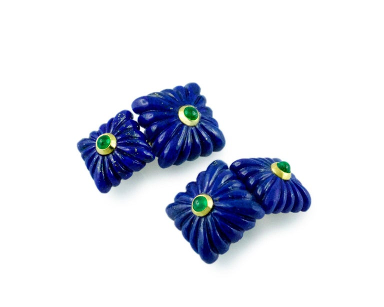 "These striking cufflinks are entirely made of lapis lazuli, whose striking deep blue shade highlights the classic ""fesonato"" texture of front face and toggle. Both elements feature a squared shape that is adorned at the center with a cabochon"