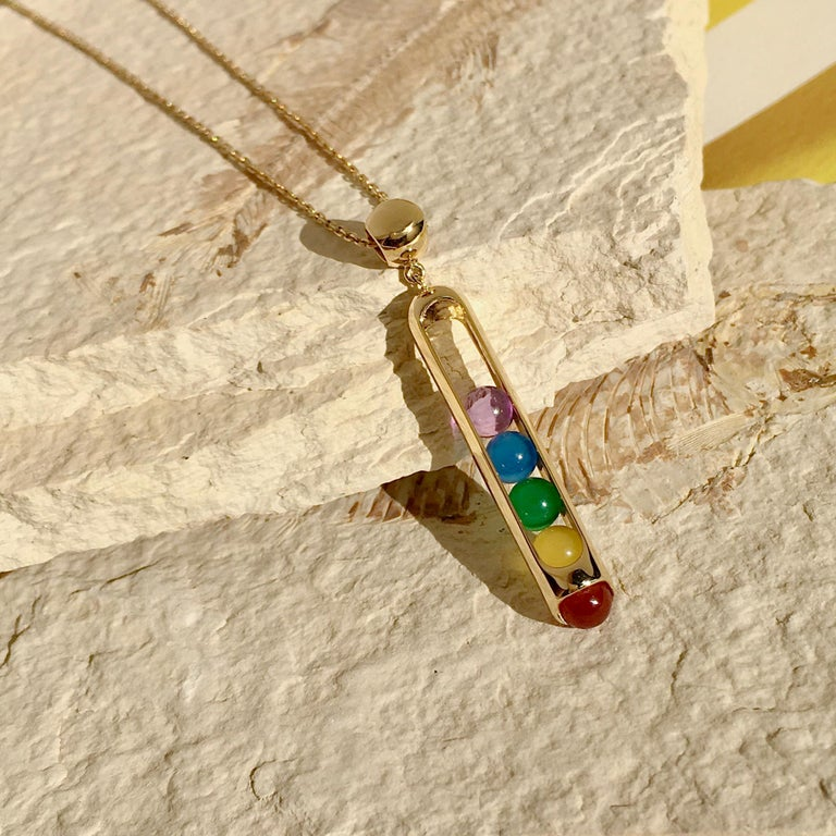 Details: 18 karat yellow gold, carnelian, yellow, green, blue chalcedony and amethyst beads.                                                 Charm length: 3.2cm Width: 0.58cm, Chain length: 23.5 inches(60cm)  We carefully selects each of our