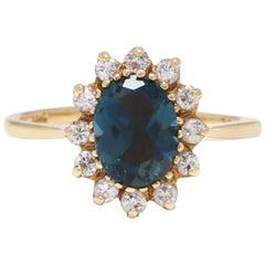 18 Karat Yellow Gold, London Blue Topaz and Diamond Ring