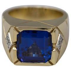 18 Karat Yellow Gold Men's Emerald Cut Tanzanite and Diamond Ring 12.02 Carat