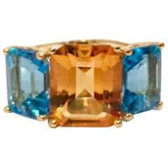 18 Karat Yellow Gold Mini Emerald Cut Ring with Orange Citrine and Blue Topaz