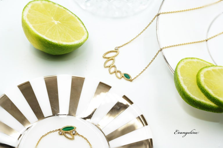 18k yellow gold, 5.4g.  2 Diamonds, Total Carat Weight: 0.06ct Stone: Malachite  This charming delicate Q Garden necklace is the ideal piece for any occasion. As the latest addition to the popular Q Garden collection, the Mini Q Garden collection