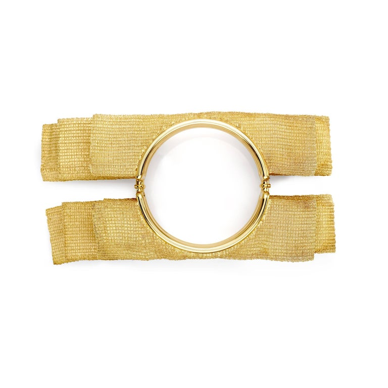 II finalist at the Oscar Jewelery comeptition in 2012 Chocker Bangle and ring Total weight of yellow gold 18 kt gr 797,2 Stamp 750