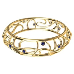 18 Karat Yellow Gold Oceans Sapphires Bangle