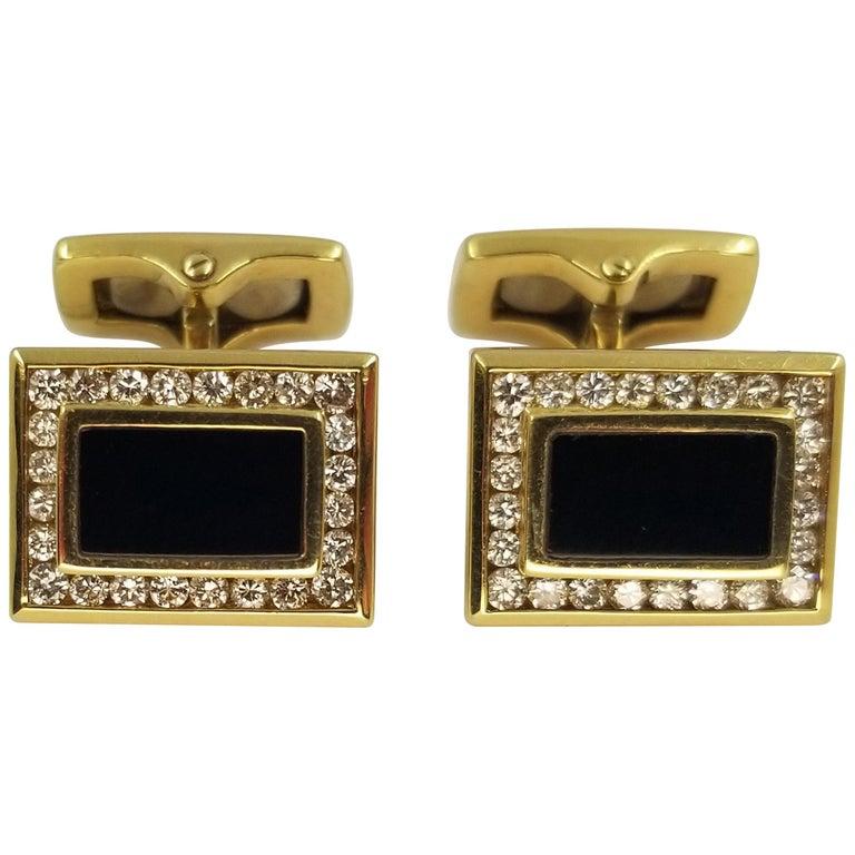 18 Karat Yellow Gold, Onyx, and Diamond Cufflinks