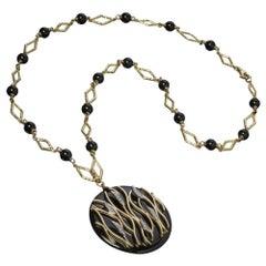 18 Karat Yellow Gold, Onyx and Diamond Pendant Necklace
