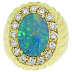 18 Karat Yellow Gold Opal and 1.12 Carat Diamond Ring