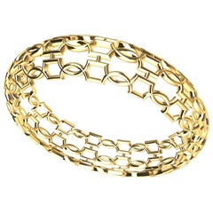 18 Karat Yellow Gold Open Circles Bangle