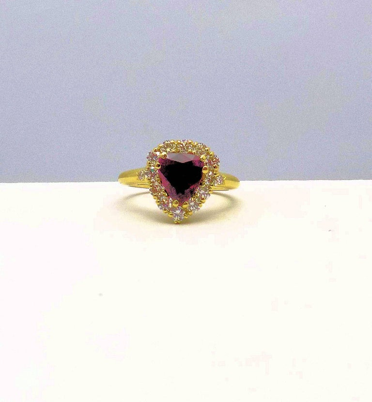18 Karat Yellow Gold Ring Featuring 2.03 Carat Pear Shape Ruby in Diamond Halo Ring. Ruby 2.03 Carat with Lab Report #171019E-JG; 14 Round Brilliant Diamonds 0.70 Carat Total Weight, VS, H; Finger Size 7; 3.5 DWT or 5.44 Grams.