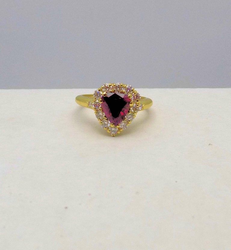 Pear Cut 18 Karat Yellow Gold Pear Shape Ruby and Diamond Ring For Sale