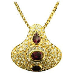 18 Karat Yellow Gold Pear-Shaped and Oval Ruby and Diamond Pendant