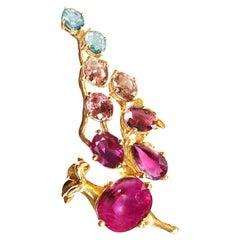 18 Karat Yellow Gold Pendant Necklace with Rubies, Sapphire and Malaya Garnets