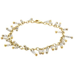18 Karat Yellow Gold, Platinum and 18 Carat Diamond Bead Anklet