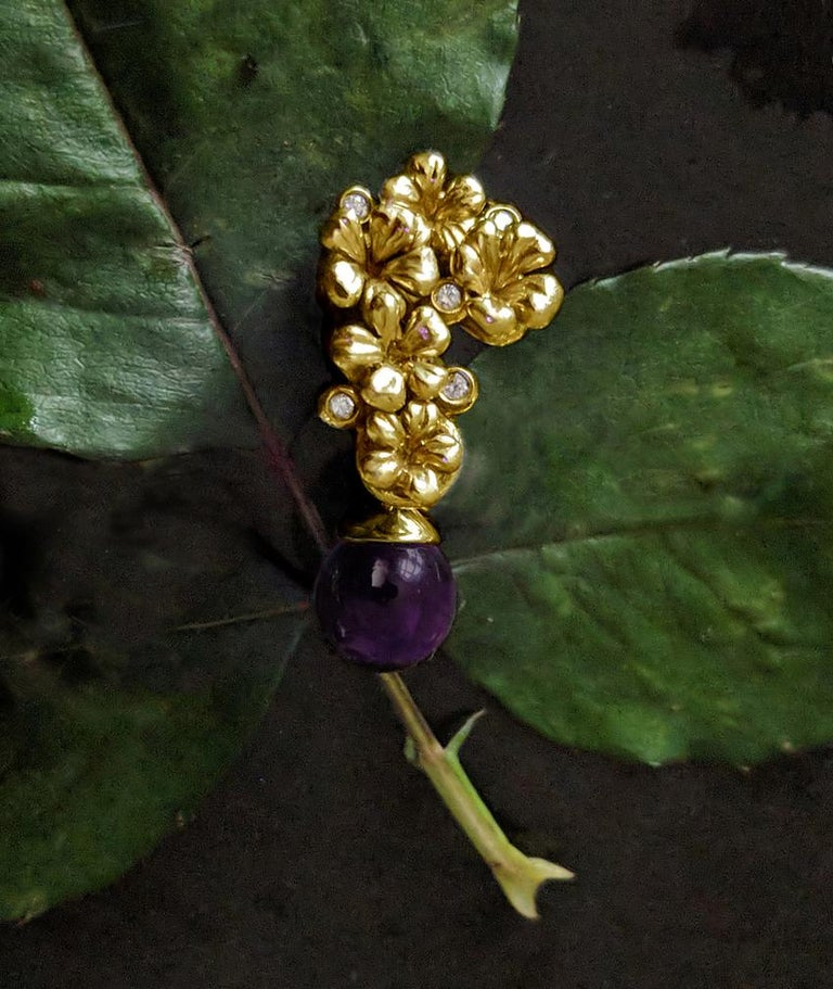 18 Karat yellow gold Plum Blossom brooch with amethyst encrusted with 5 round diamonds (0.15 Carat). This contemporary jewellery collection has been featured in Vogue UA review.  The amethyst cabochon drop gives an extra sparkle and colour to the