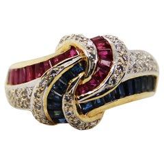 18 Karat Yellow Gold Red Ruby Blue Sapphire Diamond Knot Statement Ring