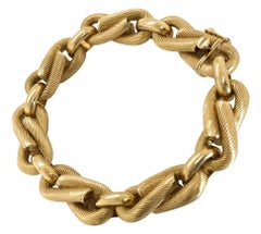 18 Karat Yellow Gold Ribbed Infinity Link Chain Bracelet