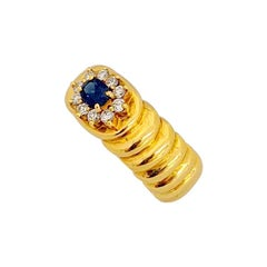 18 Karat Yellow Gold Ring with 2.27 Carat Oval Sapphire and Diamond Center