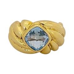 18 Karat Yellow Gold Ring with 2.80 Carat Cushion Cut Blue Topaz