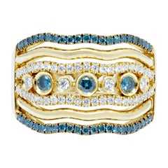 18 Karat Yellow Gold Ring with Brilliant Cut, White and Blue Diamonds