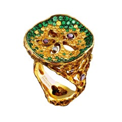 18 Karat Yellow Gold Ring with Diamonds Tsavorites and Yellow Sapphires