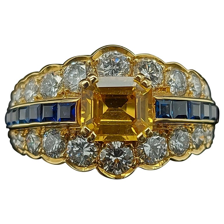 18 Karat Yellow Gold Ring with Large Yellow Sapphire Blue Sapphires and Diamonds For Sale