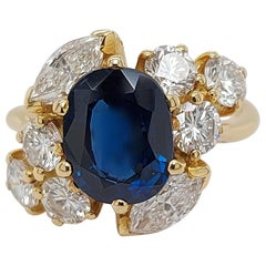 18 Karat Yellow Gold Ring with Oval Sapphire, Marquise and Round Cut Diamonds