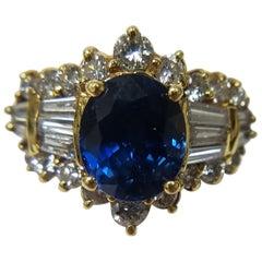 18 Karat Yellow Gold Ring with Sapphire Center Stone and Diamonds