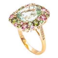 18 karat Yellow Gold Ring with Tsavorites, Saphire, Tourmaline and Diamonds