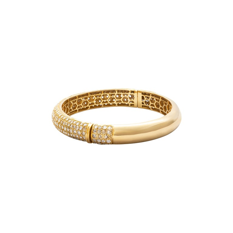 18 Karat Yellow Gold Rosecut Diamond Cuff Bracelet  Beautifully crafted cuff bracelet, set in 18 Karat yellow gold studded with rosecut diamonds. The honeycomb design on the inside is indicative of the workmanship and design that sets this bracelet