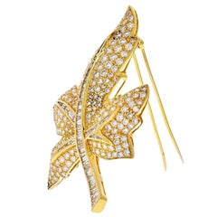 18 Karat Yellow Gold Round and Baguette Diamond Maple Leaf Brooch