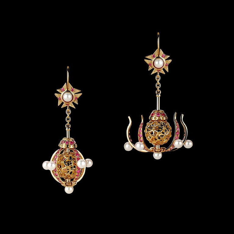 Transforming Chandelier earrings in 18K gold set with brilliant rubies and Akoya pearls in a Pomander motif. Can be worn closed (round form) or open (chandelier form). A unique modern take on an antique style.
