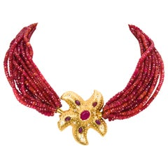 18 Karat Yellow Gold Ruby and Diamond Starfish 12 Strand Faceted Ruby Beads