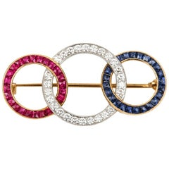 18 Karat Yellow Gold Ruby Diamond and Sapphire 'Tri-Ring' Brooch