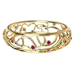 18 Karat Yellow Gold Ruby Oceans Bangle