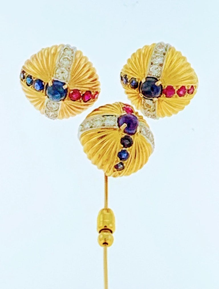 18 Karat Yellow Gold Ruby Sapphire & Diamond Earring And  Stick Pin Set Estate Each earring has one round Cabochon sapphire in the center and three rubies and three sapphires with brilliant cut diamonds to form a cross. Stick pin has same pattern