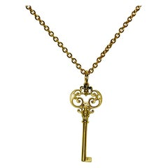 18 Karat Yellow Gold Scroll Key Charm Necklace